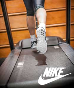 A shot of someones feet in Nike running shoes on a tread mill