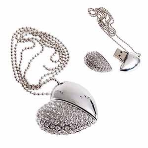 A silver USB diamond encrusted heart drive for wedding videography
