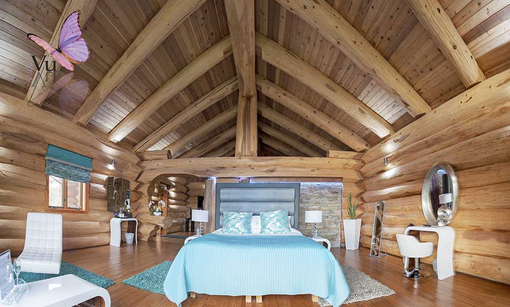 Image shows a interior shot of a bedroom in a log cabin at The Vu